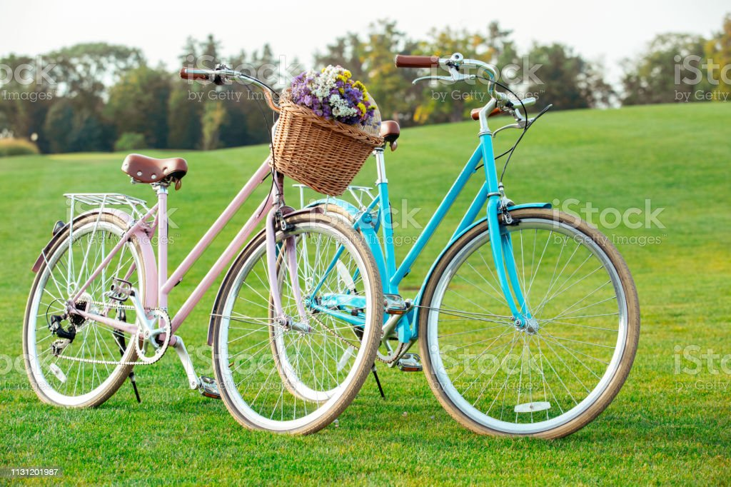 Young man and woman riding bicycle together objects