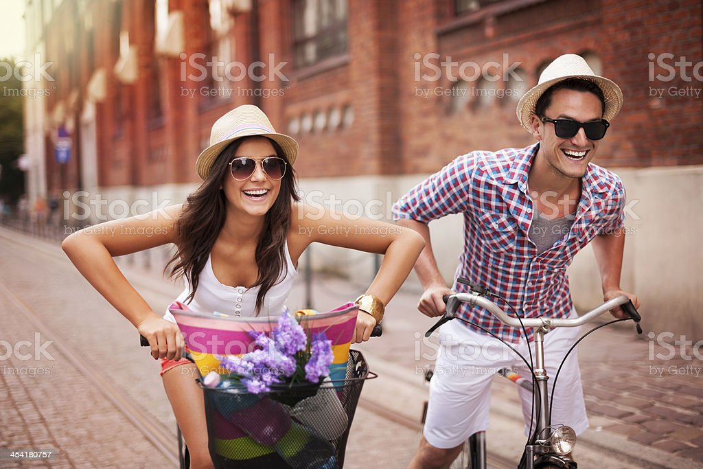 Couple riding bicycles in the city stock photo
