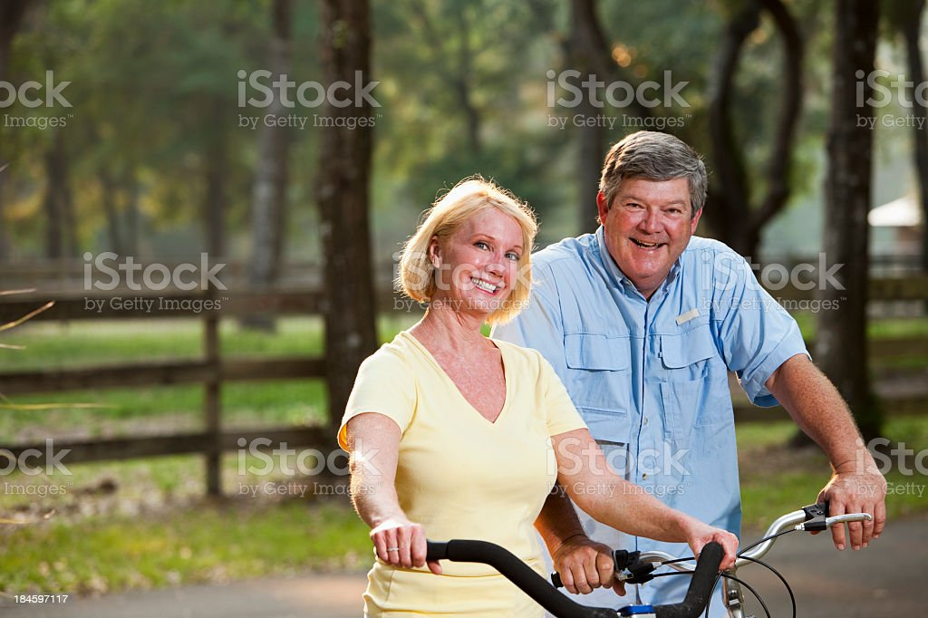 Couple riding bicycles royalty-free stock photo