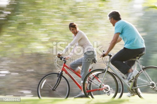 istock Couple riding bicycles together 108359440