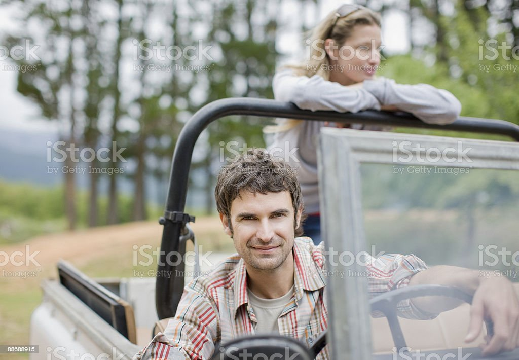 Couple riding in jeep in forest royalty-free stock photo