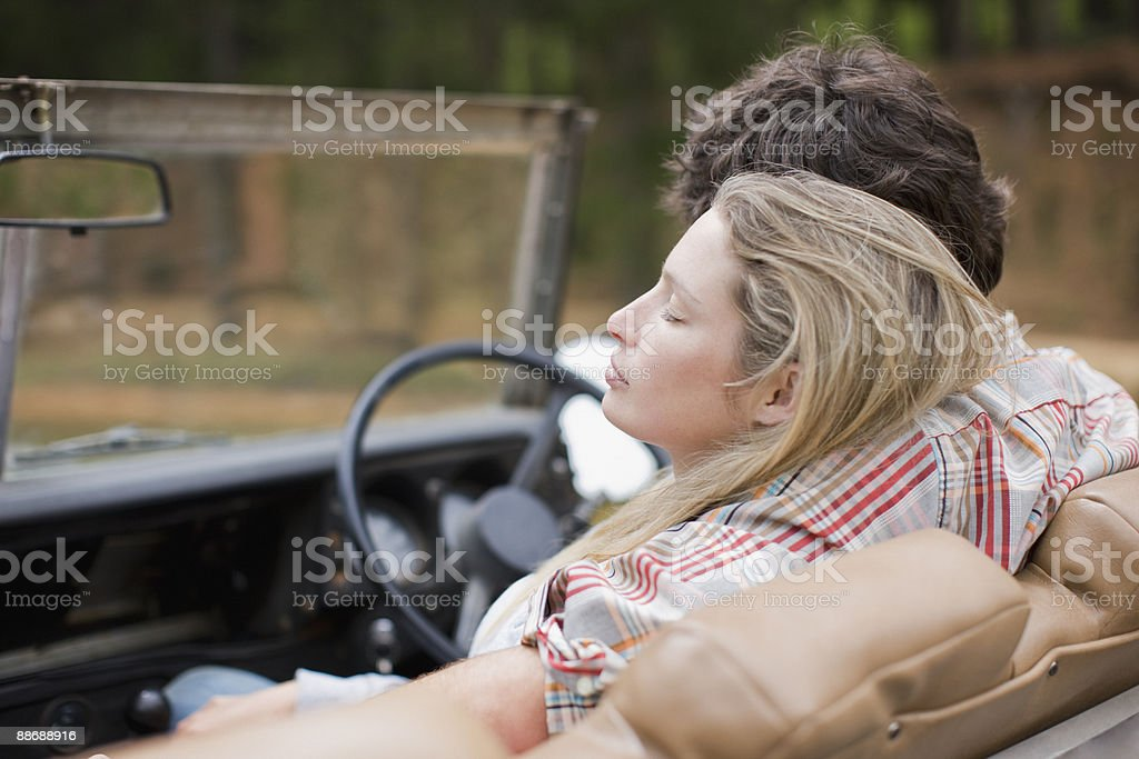Couple riding in jeep royalty-free stock photo