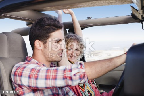 istock Couple riding in jeep together 119013937