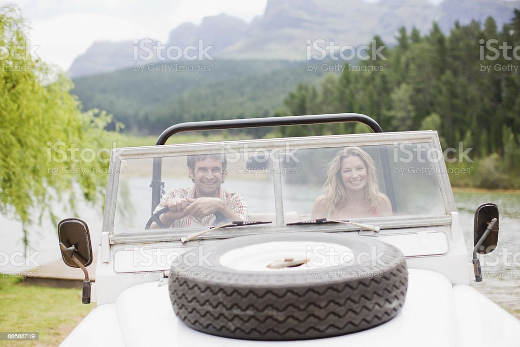 Couple riding in jeep together royalty-free stock photo