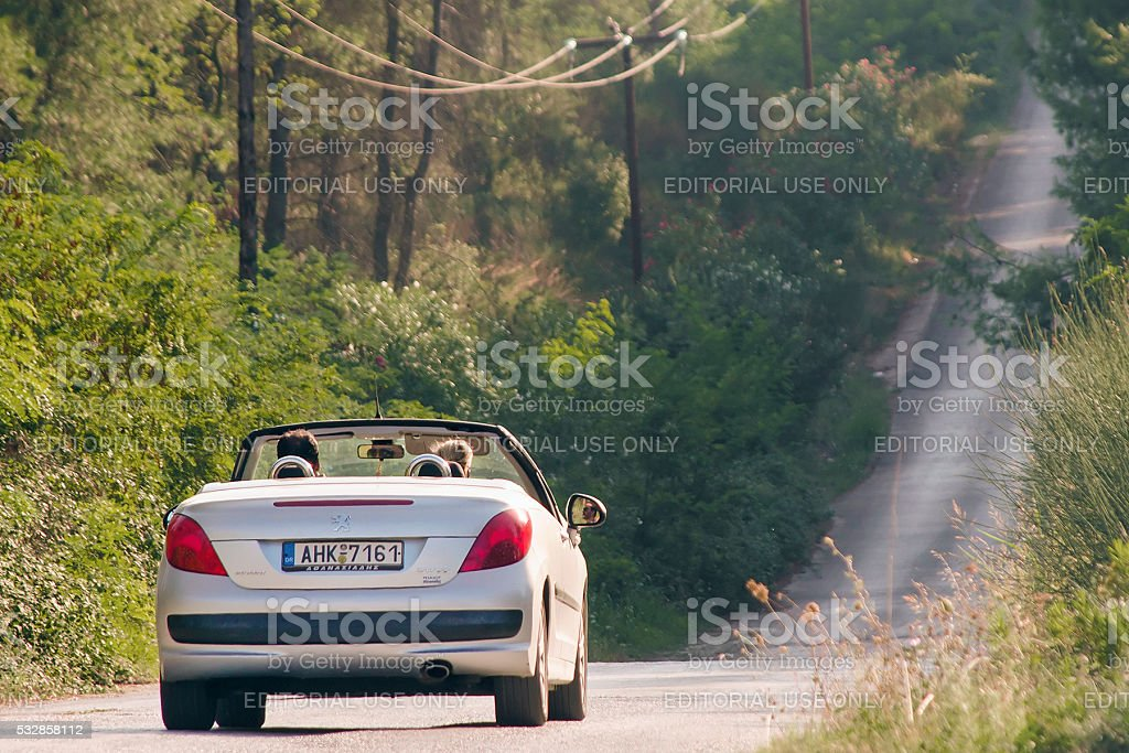 Couple riding in Peugeot 207 CC stock photo