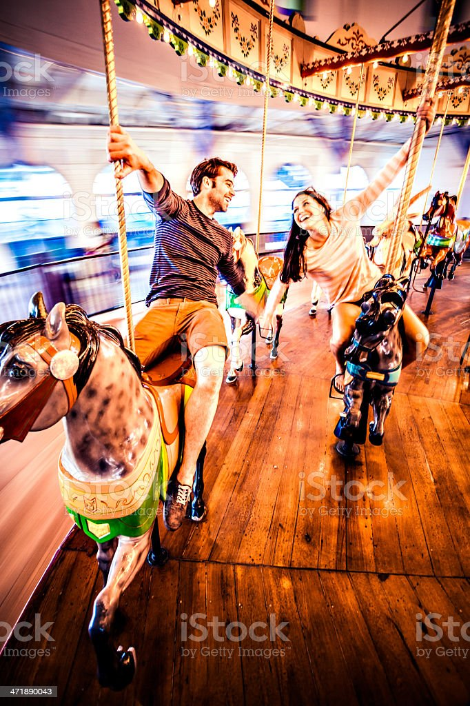 Couple riding merry-go-round in LA royalty-free stock photo