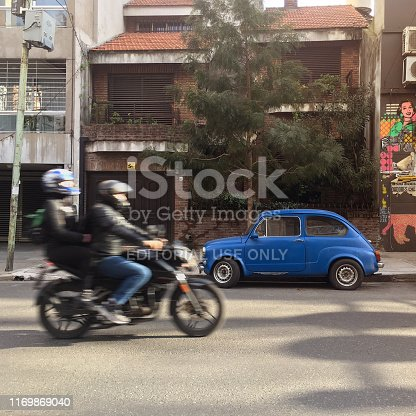 Buenos Aires, Argentina - August 23, 2019: High speed motorcycle in the street with two passengers on it. The city has a lot of cars and traffic and a lot of people prefer to use bikes to move through it