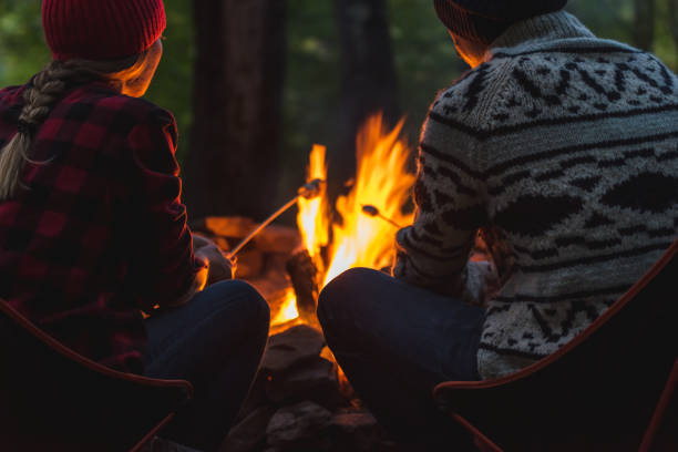 A couple roast marshmallows together stock photo