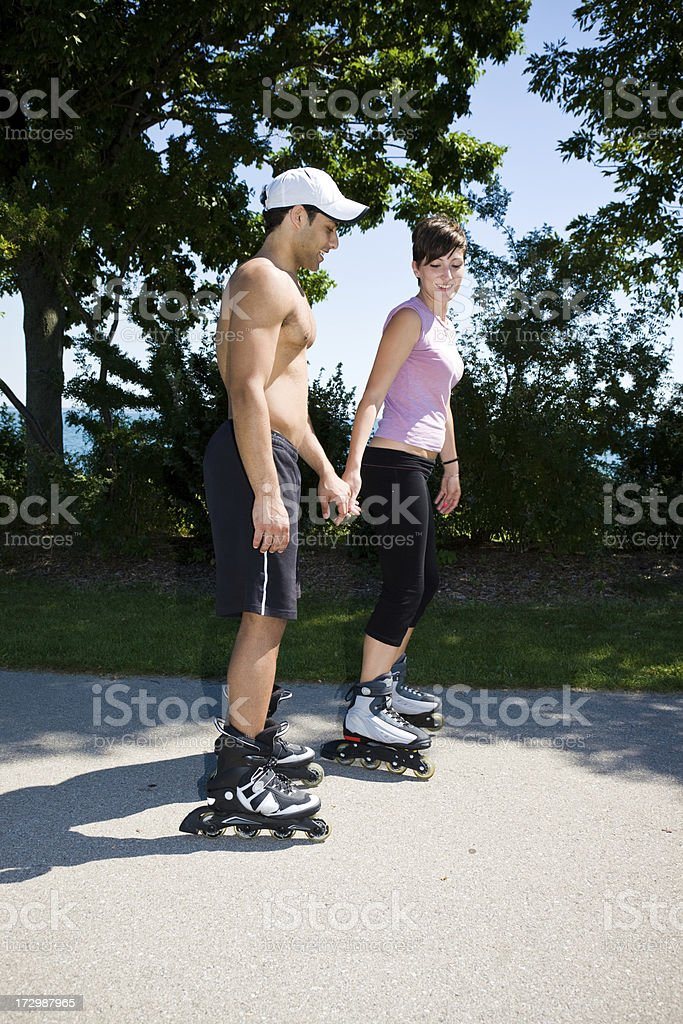 Couple roller blading royalty-free stock photo