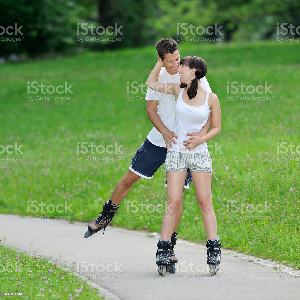 Couple roller skating - Leisure Activity (XXXL) royalty-free stock photo