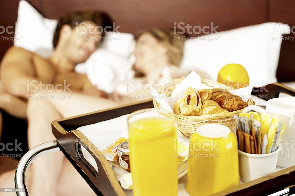 Couple romancing in bed stock photo