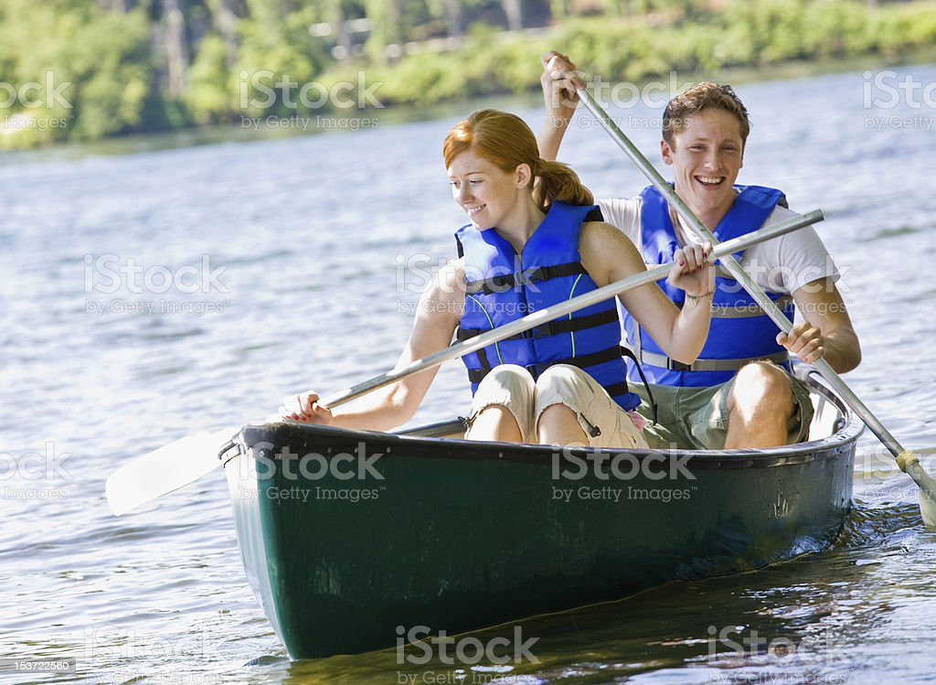 Couple rowing boat stock photo