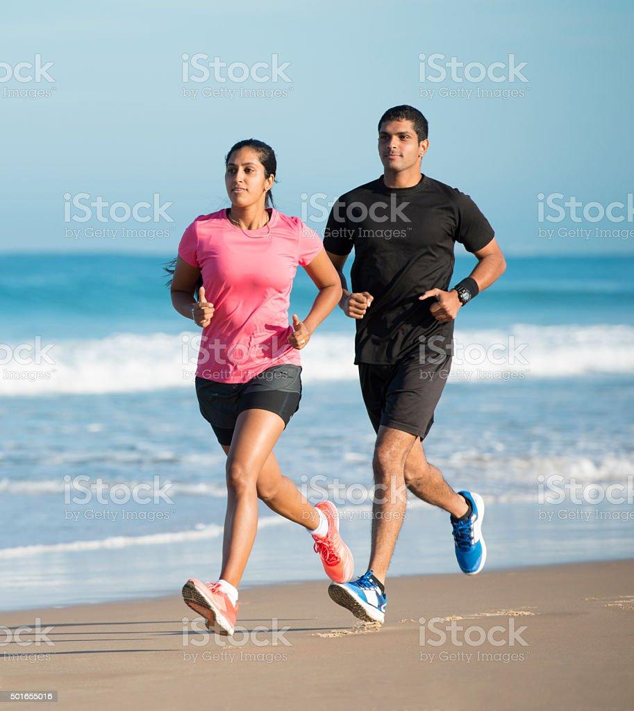Couple running at summer seaside. stock photo