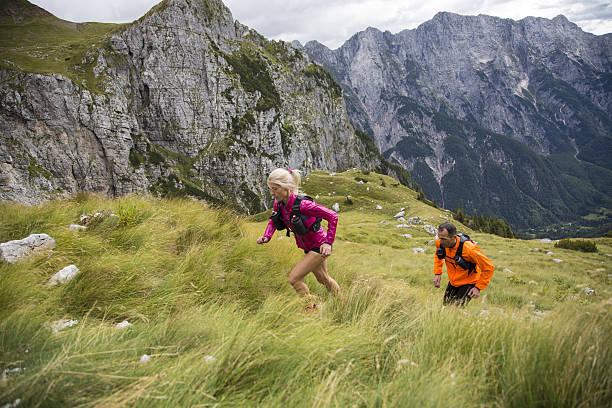 couple running on mountain - jogging hill bildbanksfoton och bilder