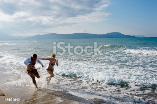 istock couple running on the beach 117191542
