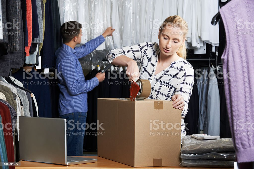 Couple Running Online Clothing Store Packing Goods For Dispatch stock photo