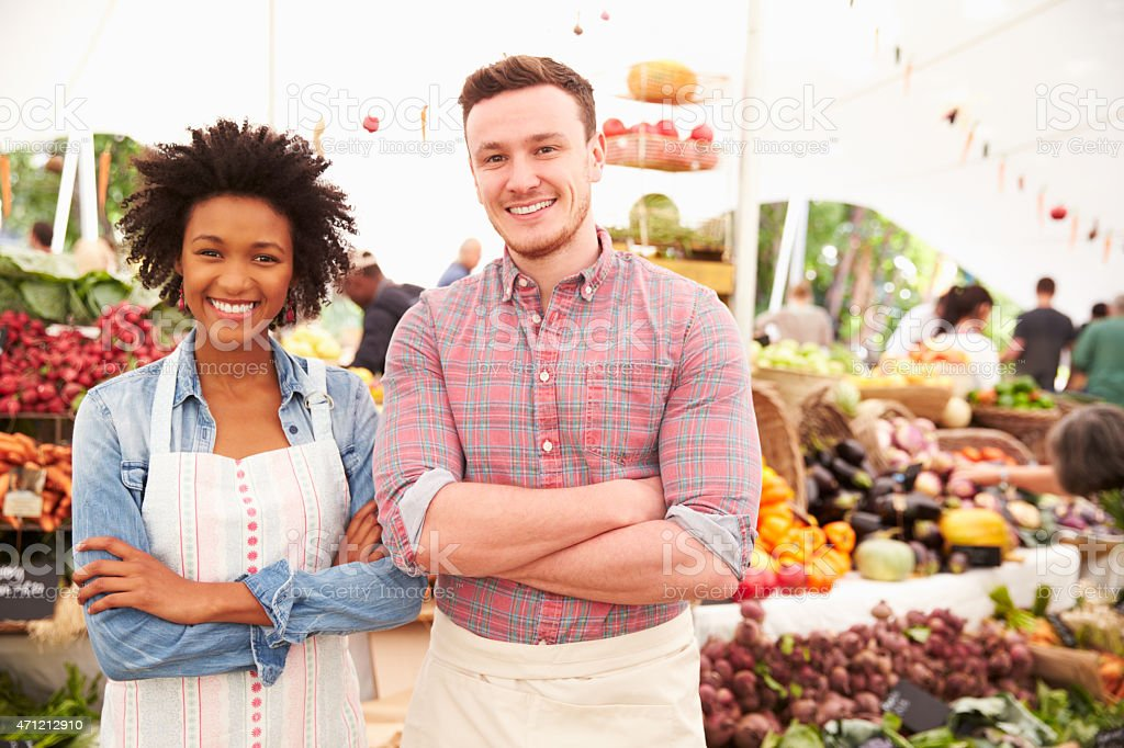 Couple Running Stall At Farmers Fresh Food Market stock photo