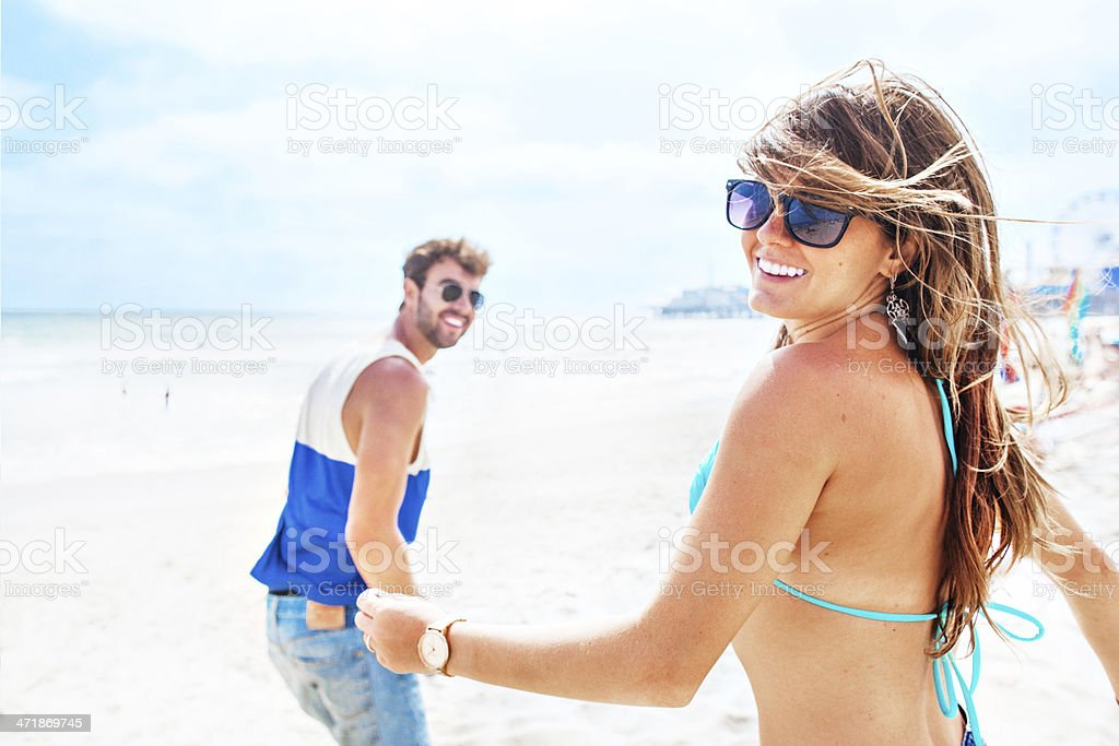 Couple running to the sea royalty-free stock photo