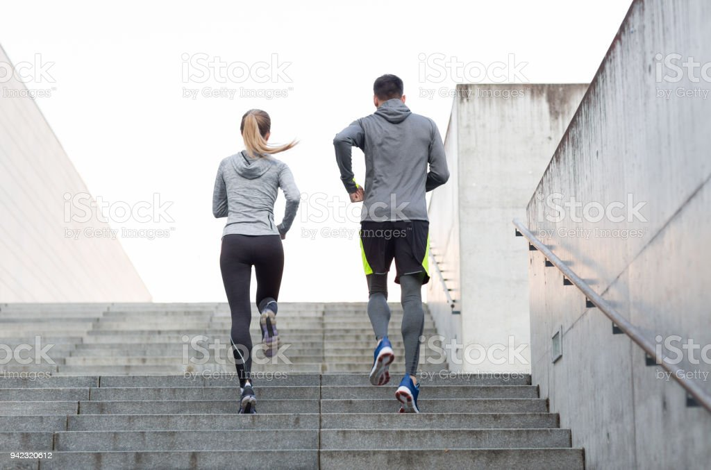fitness, sport, people, exercising and lifestyle concept - couple...