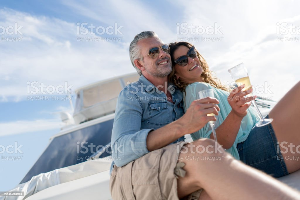 Couple sailing on a yacht stock photo