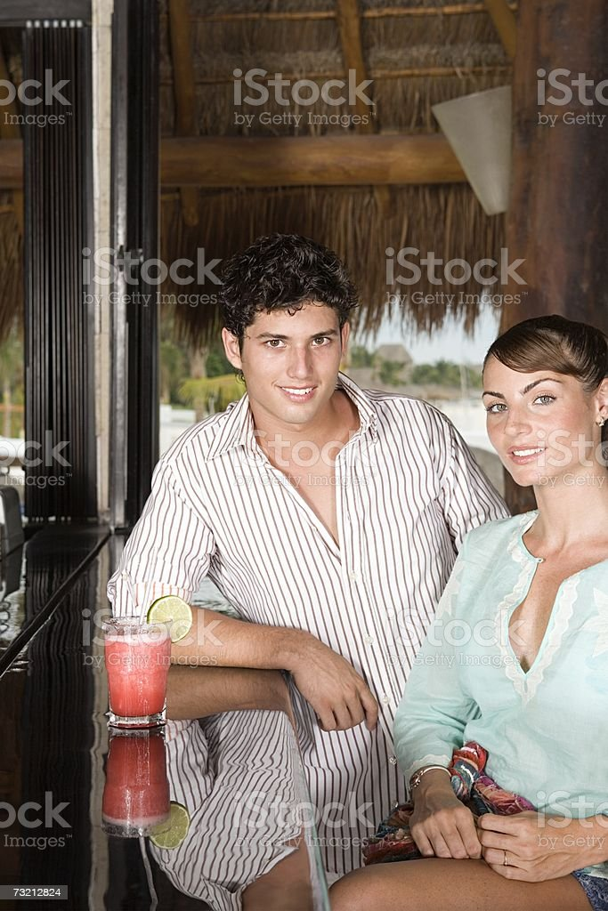 A couple sat in a bar royalty-free stock photo