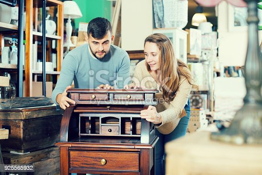 istock Couple satisfied with purchase of writing cabinet 925565932
