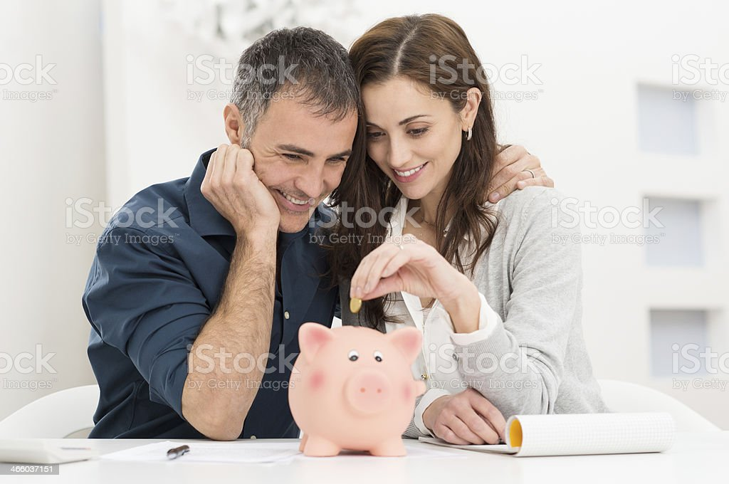 Couple Saving Money stock photo