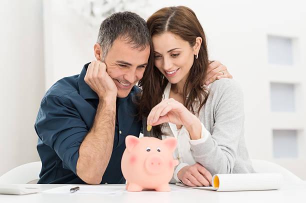 Couple Saving Money stock photo