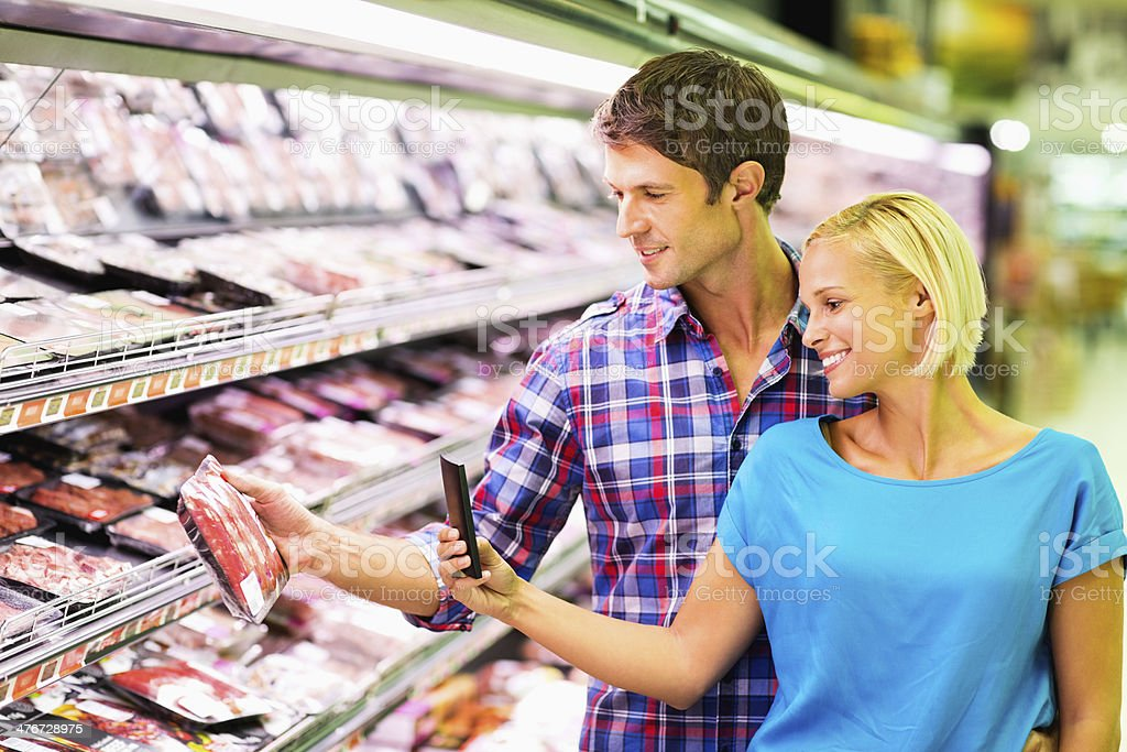 Couple Scanning Packet Using Bar Code Reader In Smart Phone royalty-free stock photo