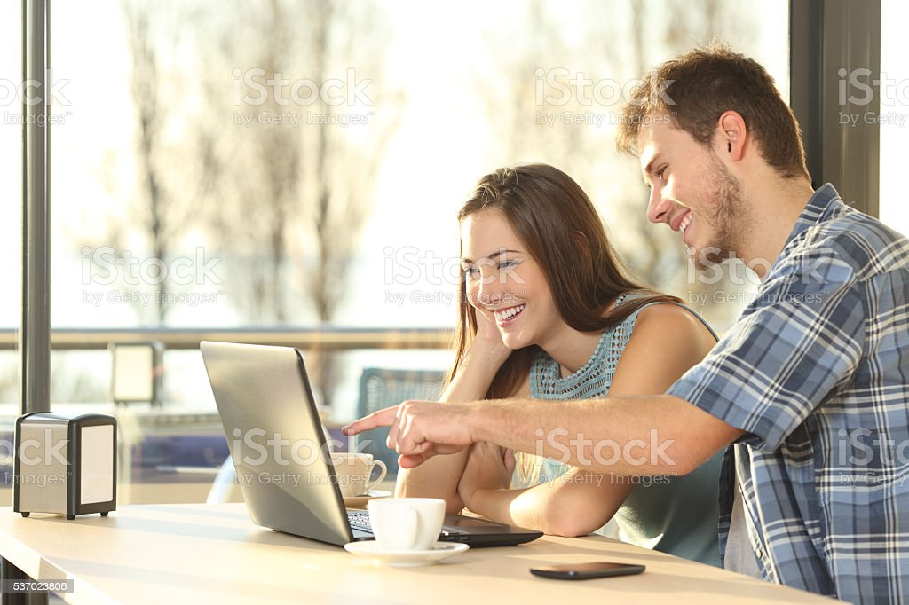 Couple searching information in a laptop stock photo