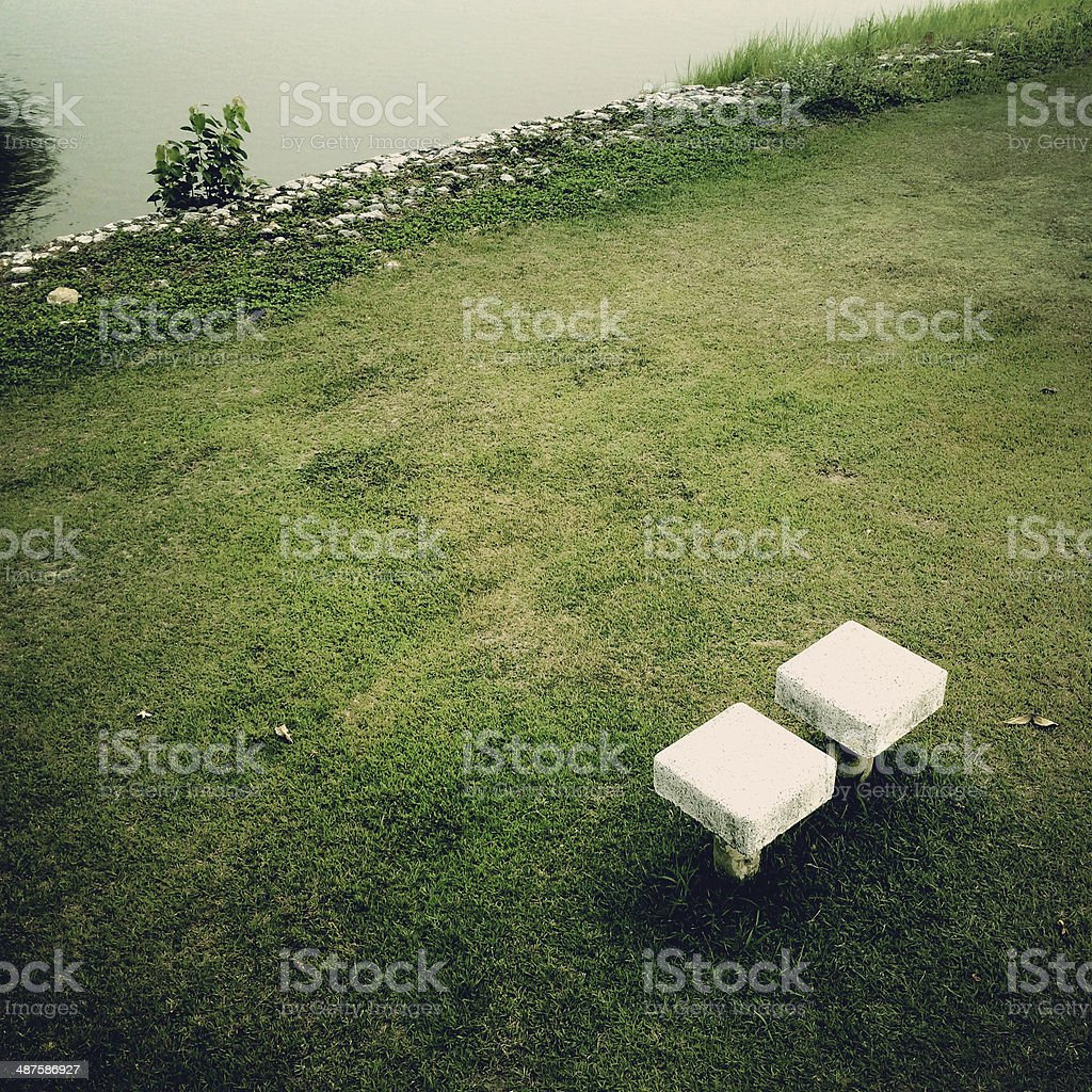 Couple seats lonely in the park royalty-free stock photo