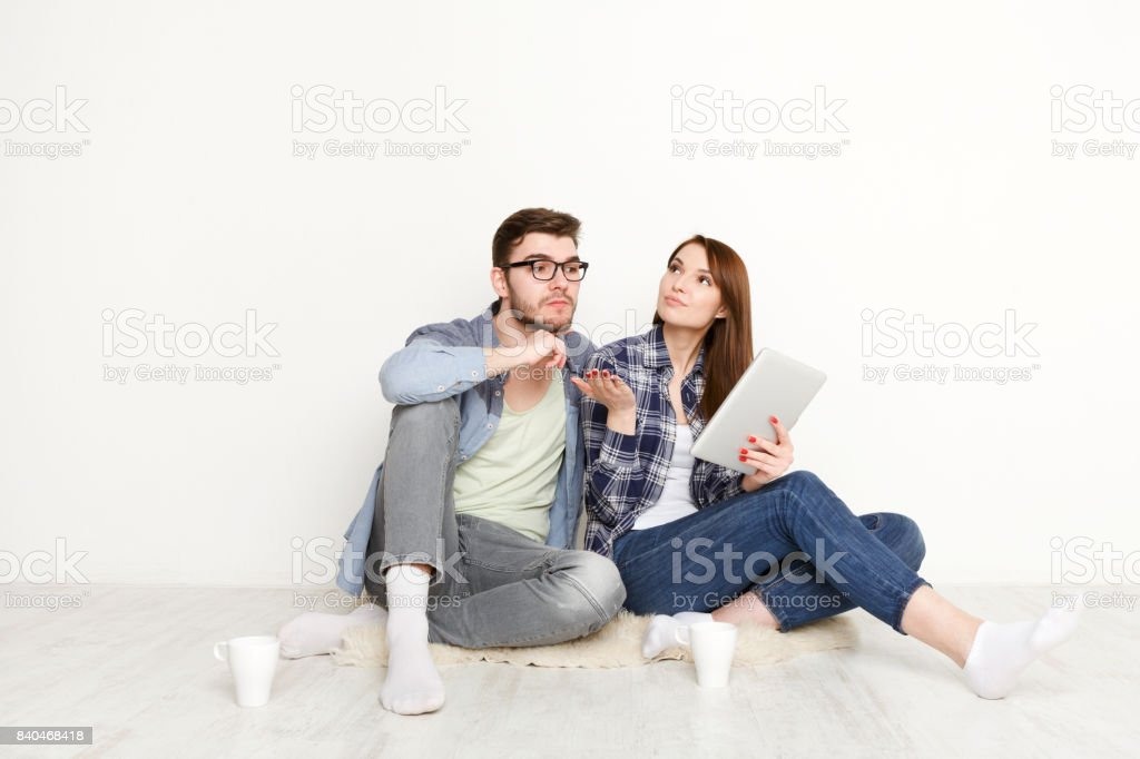 Couple selecting furniture online for new apartment stock photo
