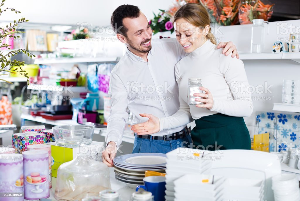 Couple selects plates stock photo