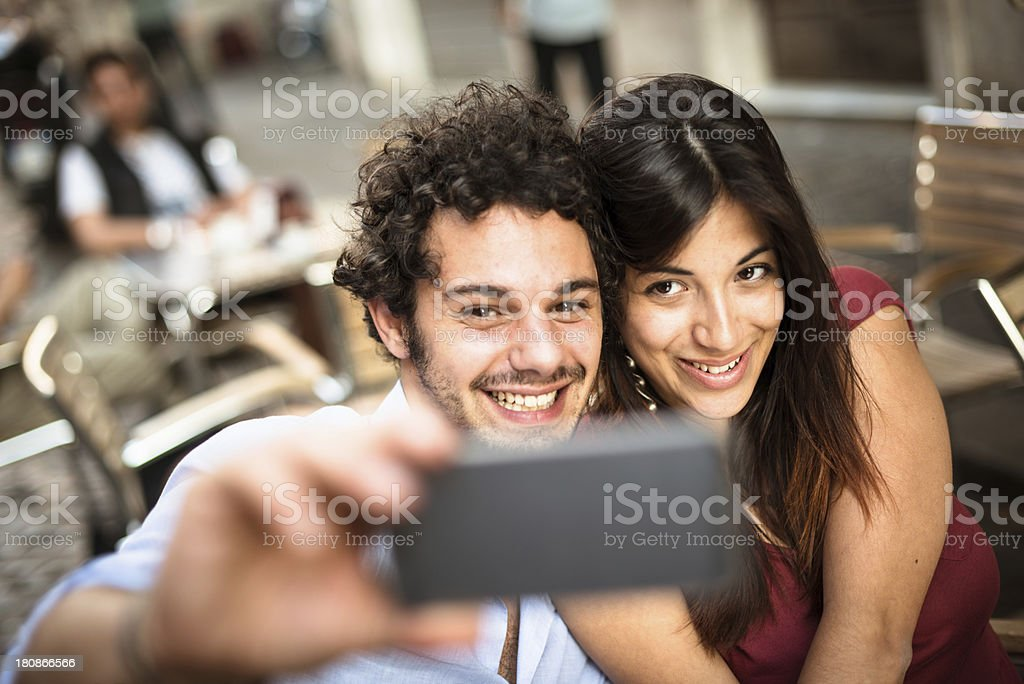 couple self photographing on the city royalty-free stock photo
