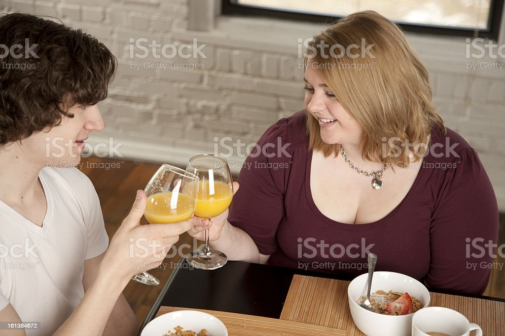 Couple Shares Breakfast With a Toast royalty-free stock photo