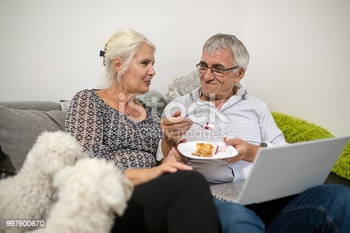 couple sharing a cake