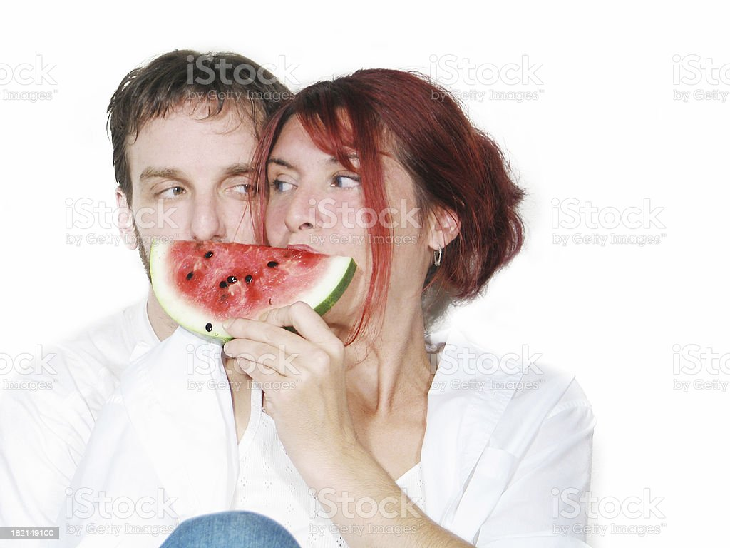 Couple sharing a slice of watermelon royalty-free stock photo