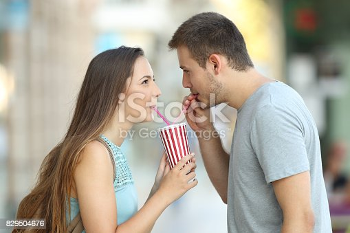 930265372 istock photo Couple sharing a takeaway refreshment 829504676