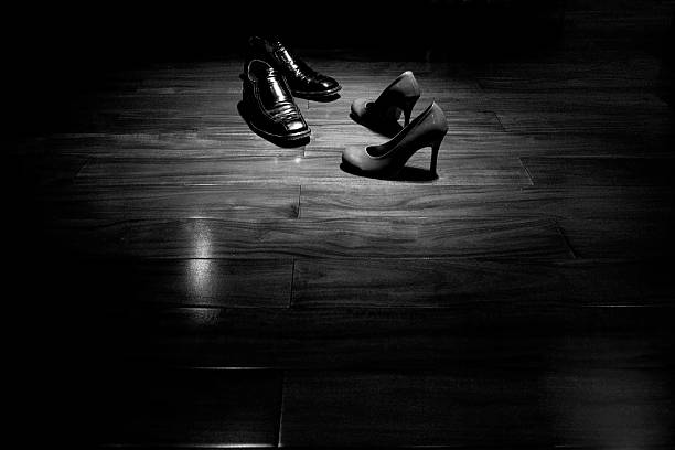 Couple shoes on dance floor in black and white stock photo