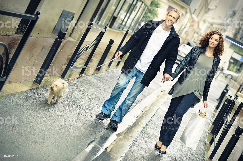 Couple shopping and walking under the rain royalty-free stock photo