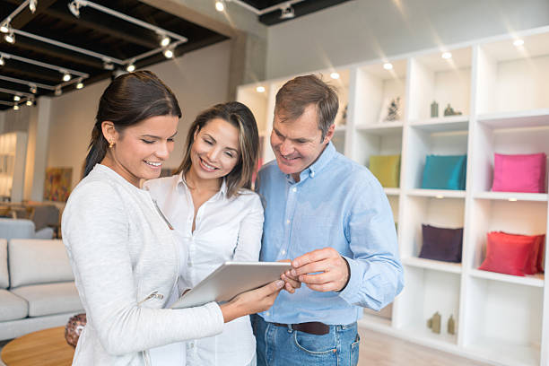 couple shopping at a furniture store - furniture shopping stock photos and pictures