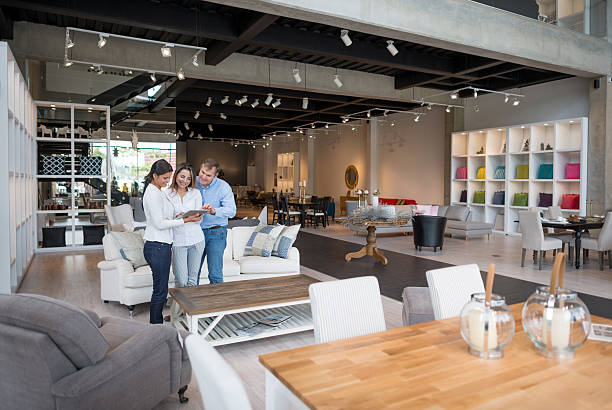 Couple shopping at a furniture store stock photo