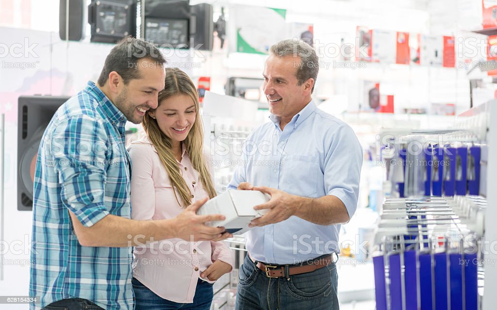 Couple shopping at a tech store stock photo