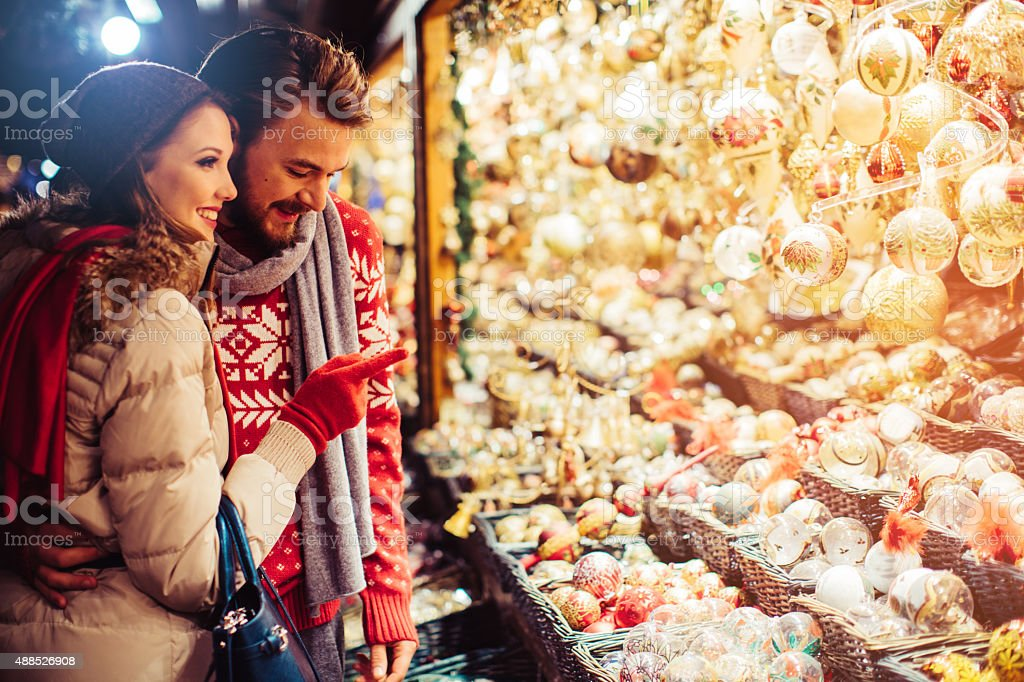Couple shopping at christmas fair. stock photo