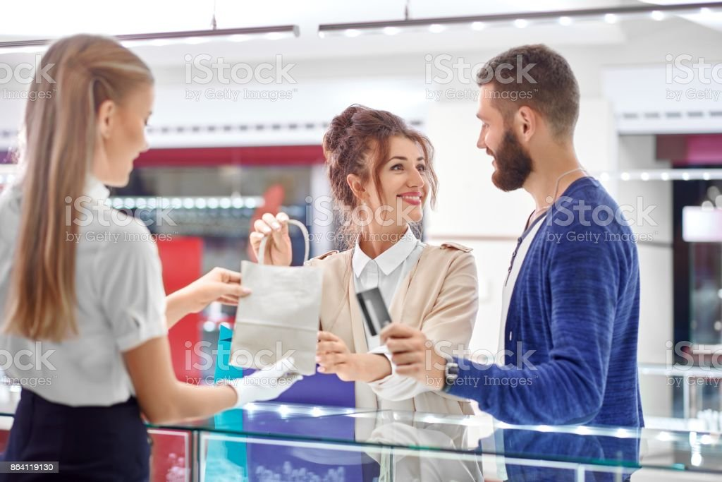 Couple shopping at jewelry store royalty-free stock photo