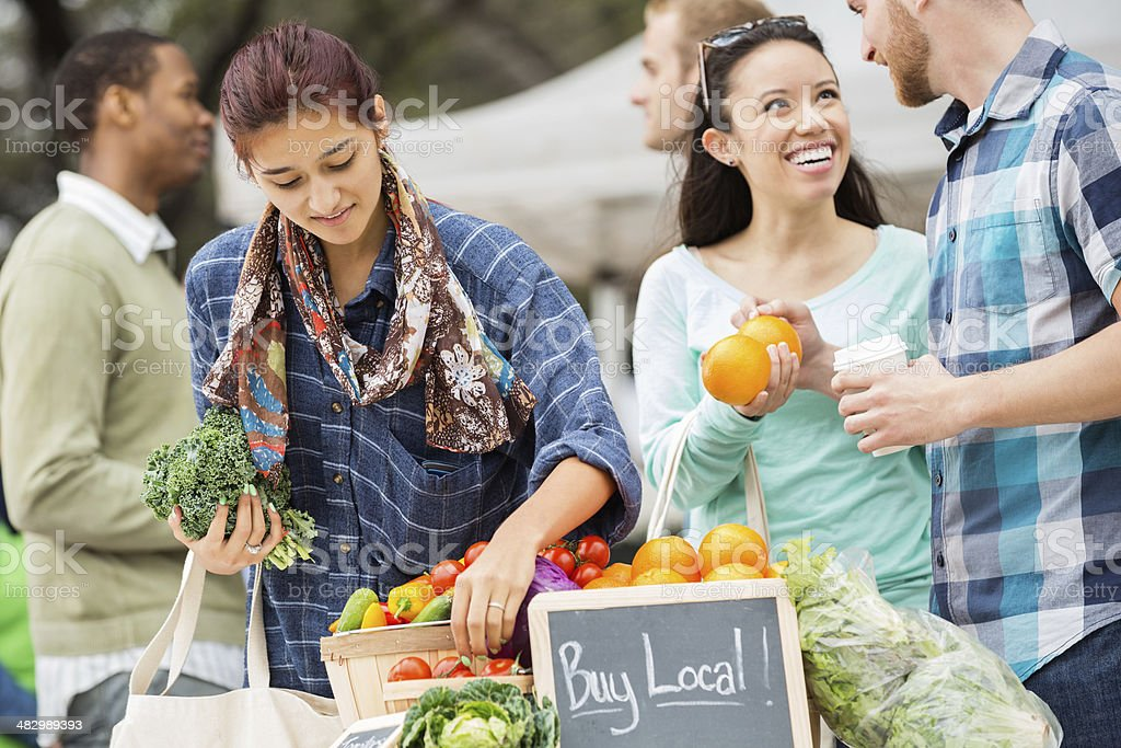Couple shopping at local farmers market stock photo