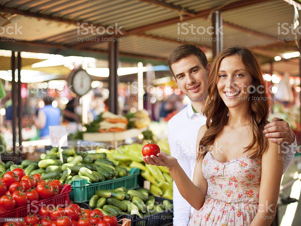 Couple shopping at market. royalty-free stock photo
