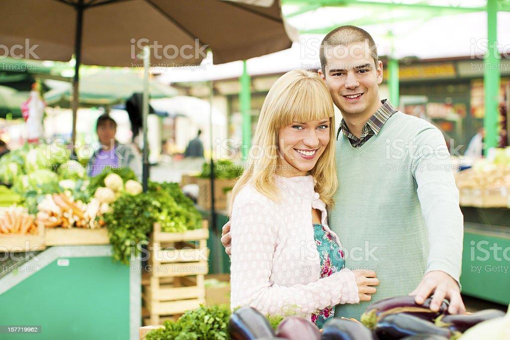 Couple shopping at open market royalty-free stock photo