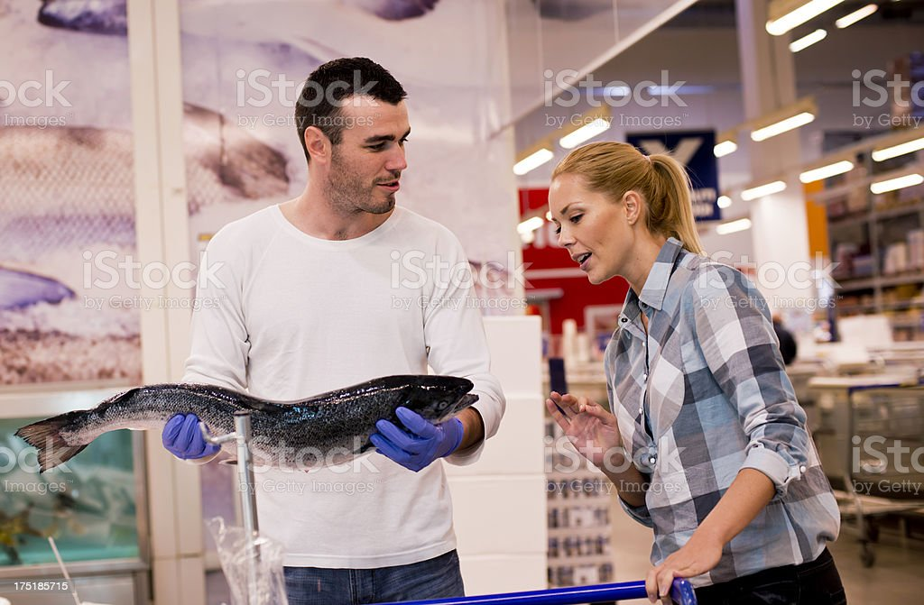 Couple shopping at supermarket royalty-free stock photo