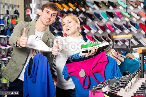 istock Couple shopping clothing in the store 617364744